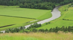 The river Tweed makes it way though the countryside, Scottish Borders Stock Footage