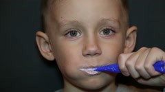 A boy brushing his teeth Stock Footage