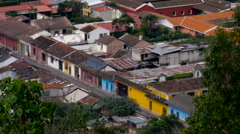 People walking down the colorful streets of Antigua shot from above Stock Footage