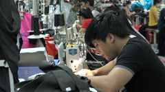Production line of a garment factory in Southeast Asia Stock Footage