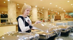 Woman chooses a meal in the cafe with self-service Stock Footage