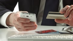 Man's hands holding a credit card and using smart phone for online shopping Stock Footage