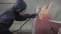 Footage of a Car being Painted by Painting Gun Stock Footage