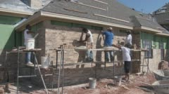 Brick layers construct new house in Texas  - stock footage