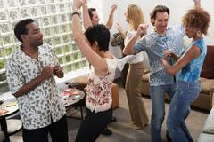 Dancing at a house party - stock photo
