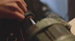 Crafting leather on a vintage machine Stock Footage
