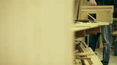 Carpenter at work wood workshop Stock Footage