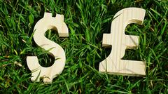 Exchange currency unit on a grass background Stock Photos
