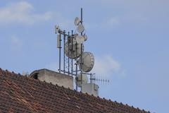 Antennas on a roof - stock photo