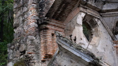 Medium pan of a church destroyed in an earthquake in Antigua, Guatemala Stock Footage