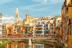 Girona. Multi-colored facades of houses on the river Onyar. Stock Photos