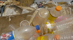 Handheld box of empty plastic bottles at a busy recycling dump center Stock Footage