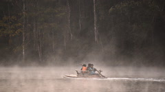 Bamboo rafting through the mist on the lake in morning at Pang-ung, Pine forest Stock Footage