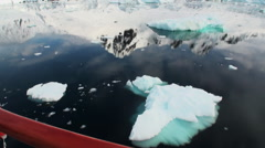 Ice and small icebergs floats on ocean surface. Stock Footage