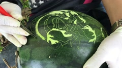 Carving a dragon image in to a watermelon Stock Footage
