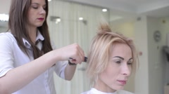 Stock Video Footage of Make up artist and hair dresser work with beautiful blonde woman model