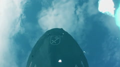 Reflection of nose of ship from surface of ocean. Stock Footage