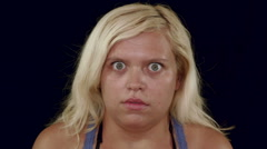Funny shocked woman with goggled eyes staring at you Stock Footage