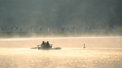 Bamboo rafting through the mist on the lake in morning at Pang-ung, Pine forest - stock footage