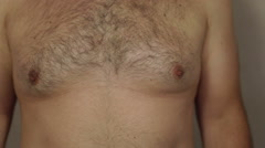 Corpulent male hairy chest detail Stock Footage