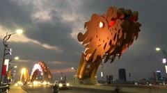 Traffic in the evening at the Dragon Bridge Stock Footage