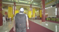Man entering the Thean Hou Temple in Kuala Lumpur Stock Footage