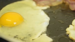 Fried Egg & Bacon Cooking. Close Up Slow Motion Stock Footage