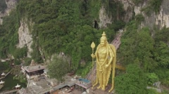 Flight over Murugan statue, Batu Caves Stock Footage