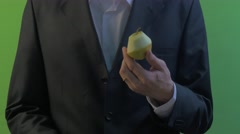 Man is Cutting an Apple Around With Knife Fruit in Hand Green Screen Young Stock Footage