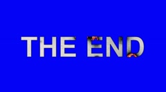 The Words THE END Burning in Flames to Ashes on a Blue Screen Background - stock footage