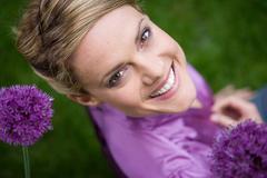 Stock Photo of Woman amongst allium flowers