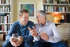 Senior man giving advice to younger man Stock Photos