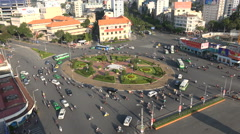 Traffic drives over a busy roundabout in Ho Chi Minh City in Vietnam Stock Footage