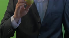 Man Bites an Apple Fruit in His Hand on a Green Screen Man's Hands Young Stock Footage