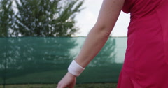 Female Tennis Player Throws The Ball To Serve Stock Footage