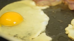 Fried Egg & Bacon Cooking. Close Up Stock Footage