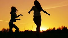 Cinemagraph.Friends, girls enjoy nature running in fields on sunset, slow motion Stock Footage