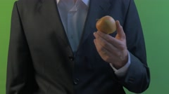 Man is Peeling an Apple With Knife Fruit in Hand on a Green Screen Young Stock Footage
