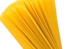 Uncooked pasta spaghetti macaroni - stock photo