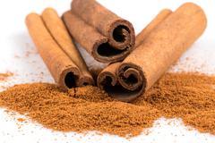 Cinnamon sticks with powder Stock Photos