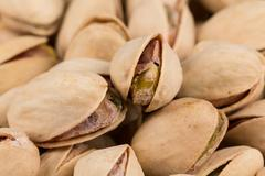 Pistachio nuts arranges as background - stock photo