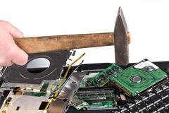 Destroying laptop with a hammer Stock Photos