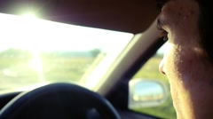 Man driving the car under sunset sky at outdoor in slowmotion. Summer time Stock Footage