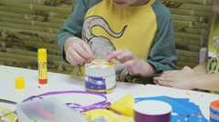 Little child makes crafts toys from cardboard Stock Footage