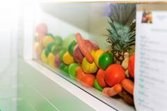 Heap of Fresh Fruits and Vegetables Exposed in White Glass Shelf Stock Photos