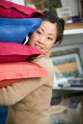 Woman shopping for cushions Stock Photos