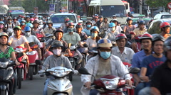 Busy rush hour traffic, motorbikes ride in central Ho Chi Minh City, Vietnam Stock Footage