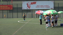 Soccer pitch, substitutes and coach, sports, Ho Chi Minh banner, Vietnam Stock Footage