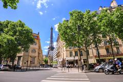 Eiffel Tower in perspective busy street - stock photo