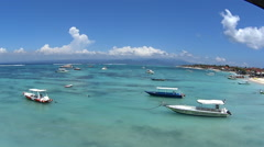 Overlooking the bay lined by boats on Nusa Lembongan island, Bali Stock Footage